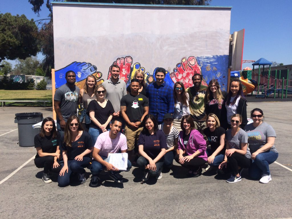 Kristi and P.S. ARTS staff pose for a picture at Grand View Elementary School