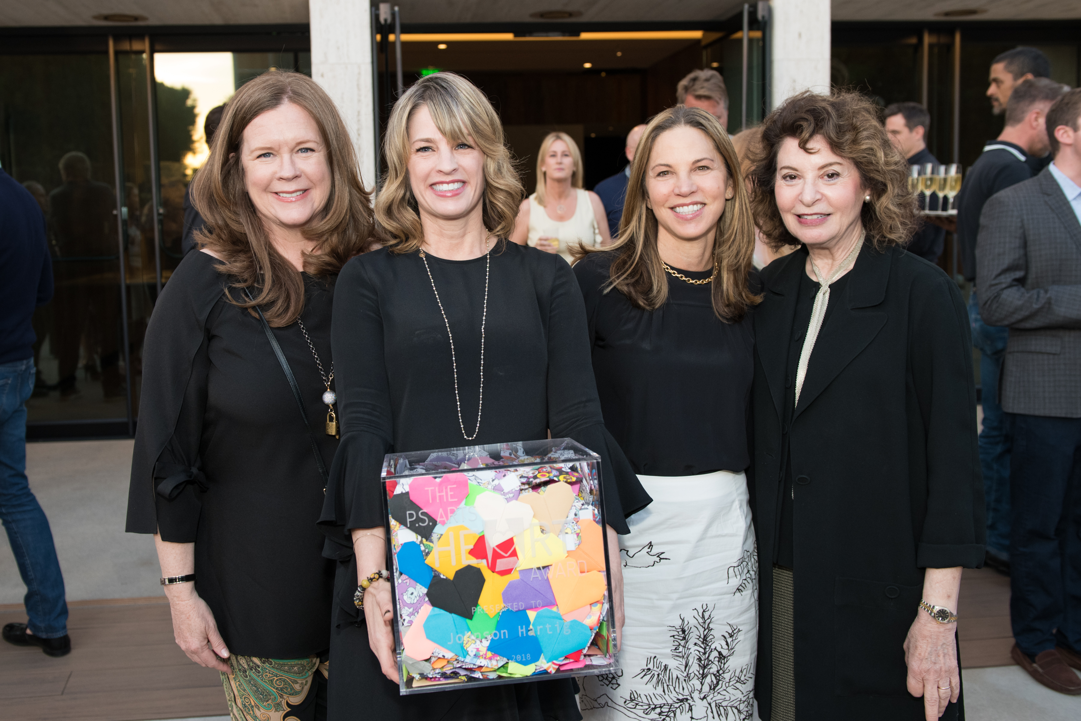 Kristi with three board members at the pARTy! in 2018