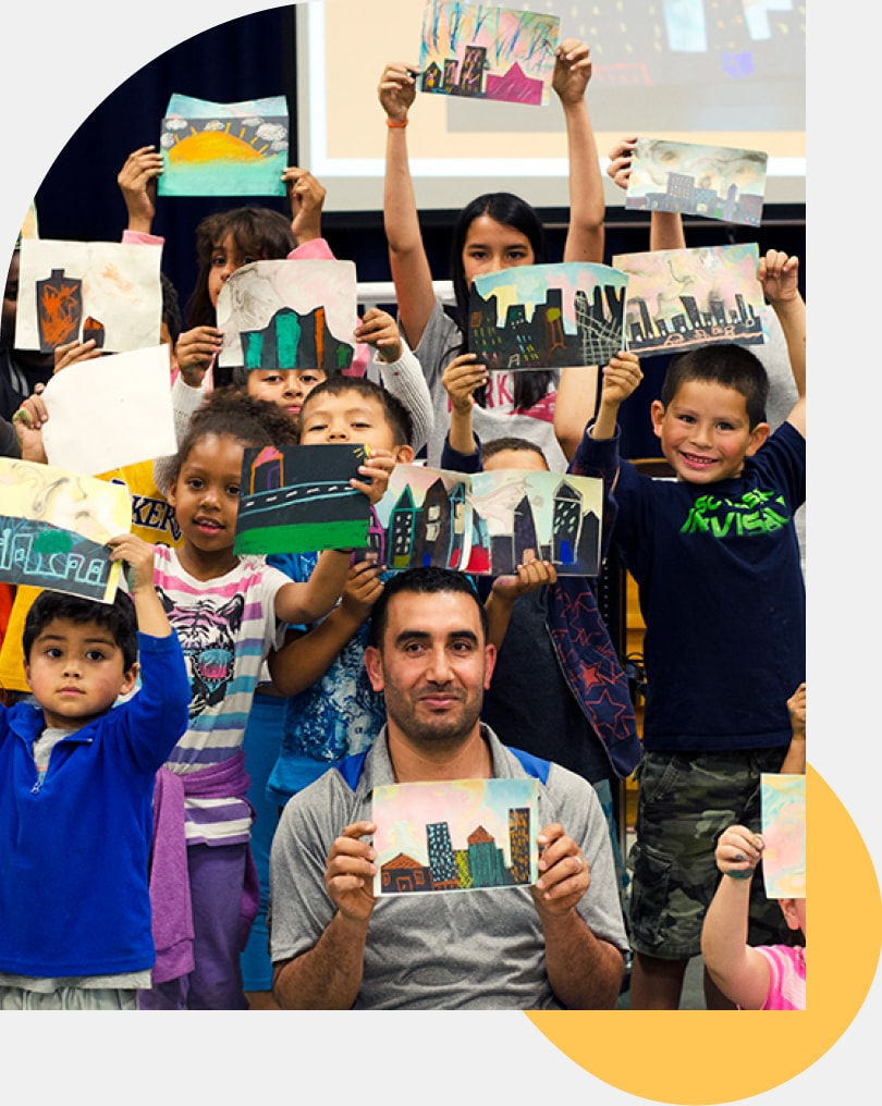 P.S. Arts man with kids and artwork